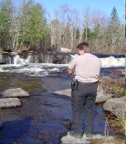 A volunteer stands guard over an active spawning site. Photo courtesy of the WI DNR.